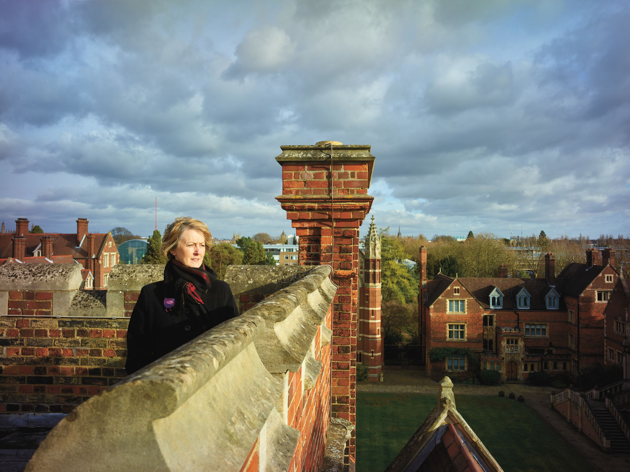 Helen Stephens, Selwyn Head Porter, at the top of the flag tower overlooking Old Court.