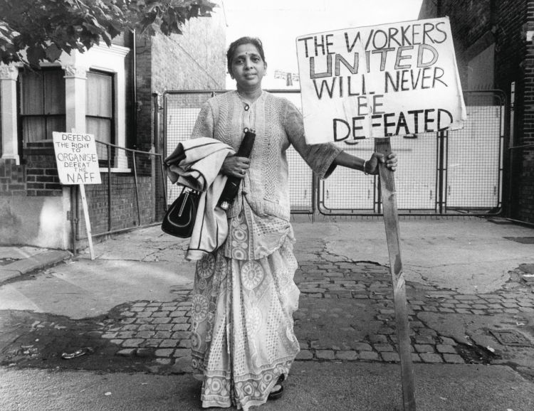 "Grunwick Strikes. The treasurer of the Grunwick strike committee, Jayaben Desai, had been picketing for a year. The sign on the left of the image reads: ""Defend the Right to Organise""."