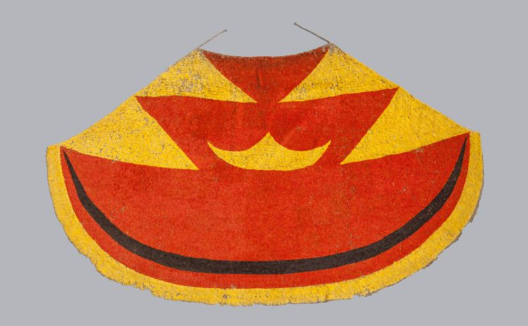 A red, yellow and black feather cloak