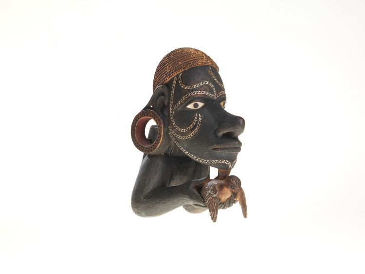 A canoe prow figure nguzunguzu; made from wood, pigments, resin and shell