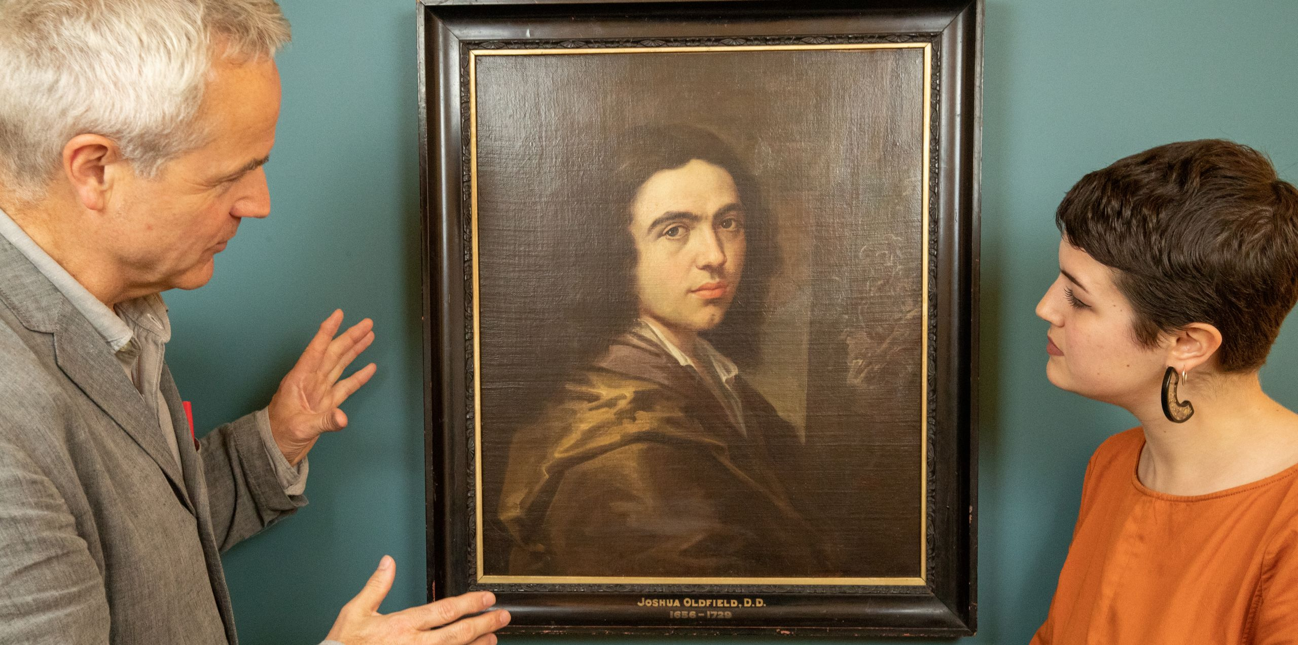 'Artist: Unknown' curators Andrew Nairne and Eliza Spindel at Kettle's Yard with Portrait of a Gentleman (oil on canvas, c.1660s).  Christ's College. Photo: University of Cambridge / Nick Saffell