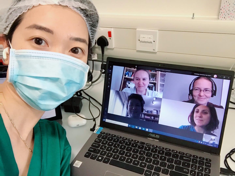 Volunteer with team members on video call