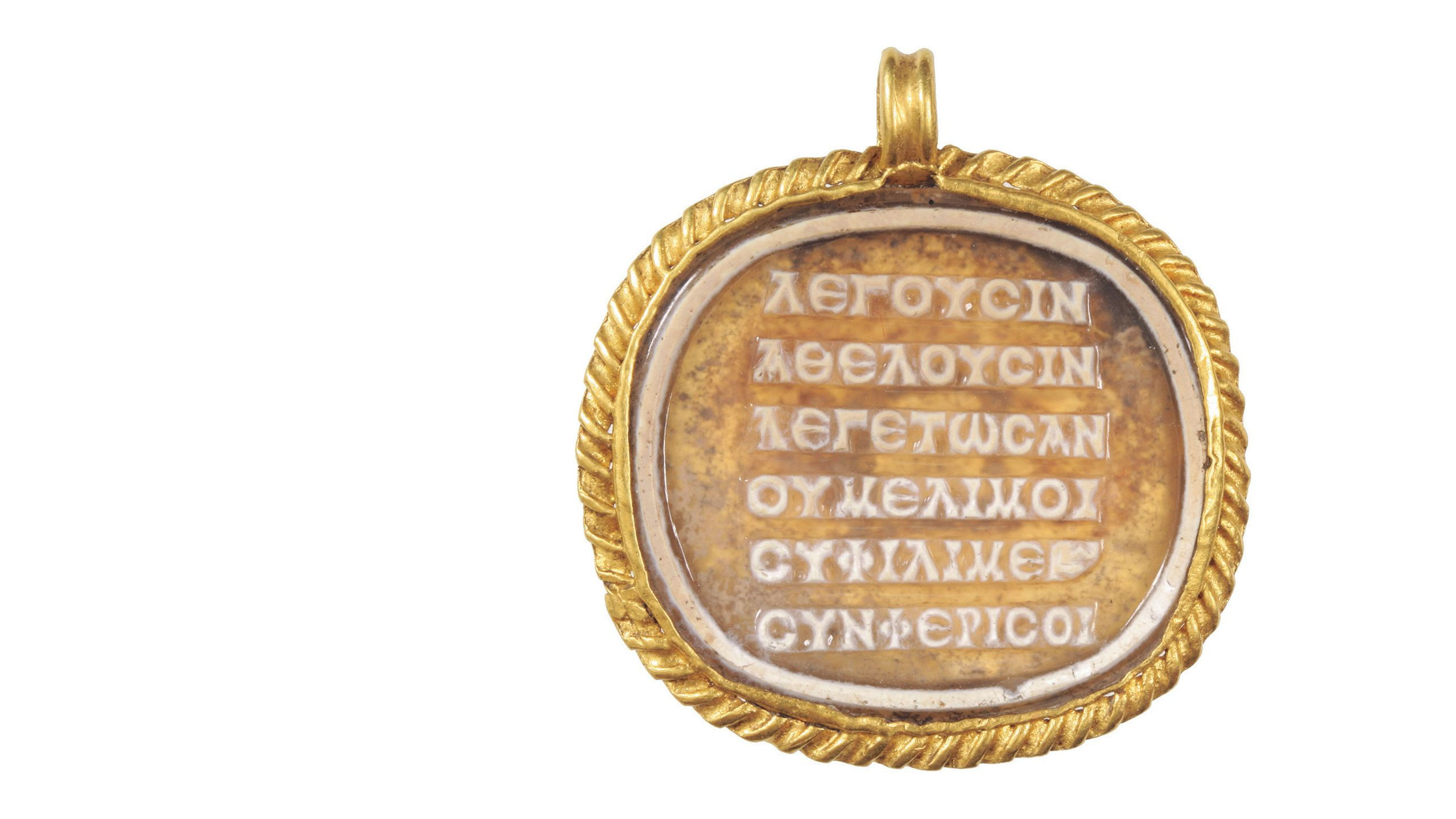 Ancient Greek 'stressed' poem inscribed on a cameo on a medallion of glass paste (2nd to 3rd century CE). Image: BHM Aquincum Museum and Archaeological Park / Péter Komjáthy