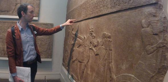 Dr Martin Worthington reads a Neo-Assyrian royal inscription in the British Museum
