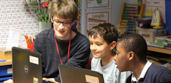 STIMULUS mentor, Alexander Simpson, with pupils at St Luke's Primary School, Cambridge.