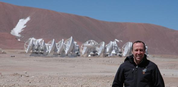 John, in front of the 12-metre-diameter antennas at the ALMA Array Operations Site