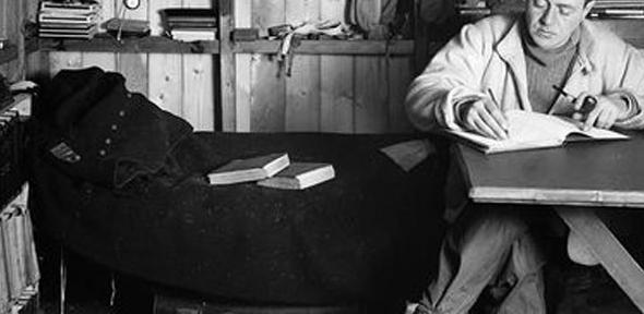 Captain Scott writing his journal during the Terra Nova expedition