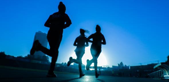 Silhouettes of three women running