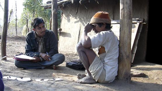 Interviewing a forest villager