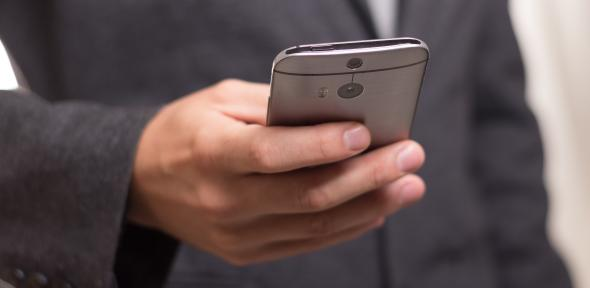 Man in suit on mobile phone