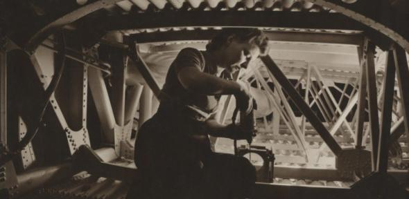 Woman working on wing section, Boeing Aircraft Company.