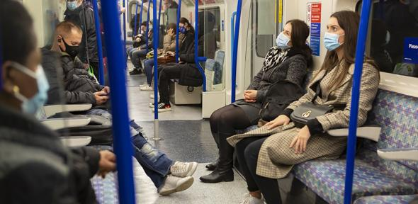 Masked commuters on the London Underground