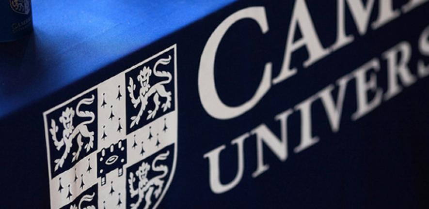 Focus on the University of Cambridge logo on a tablecloth