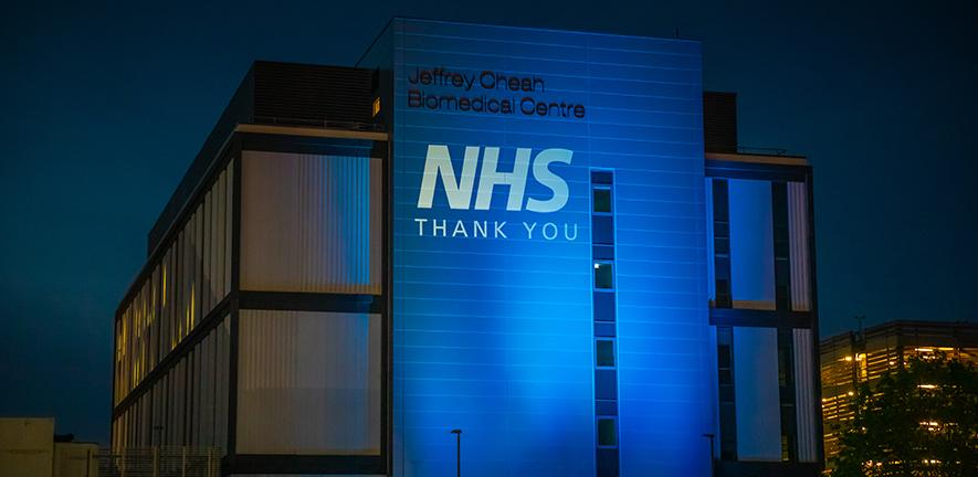 Jeffrey Cheah Biomedical Centre lit up in blue to thank the NHS
