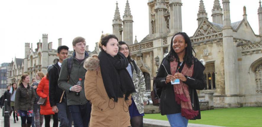 Shadows and mentors walking along King's Parade in Cambridge