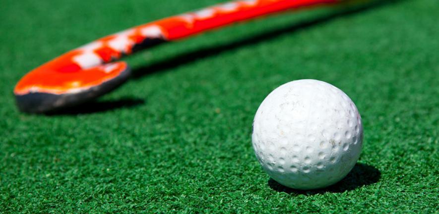 Field hockey ball and stick