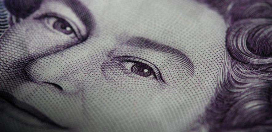 Close-up image of the Queen on a bank note