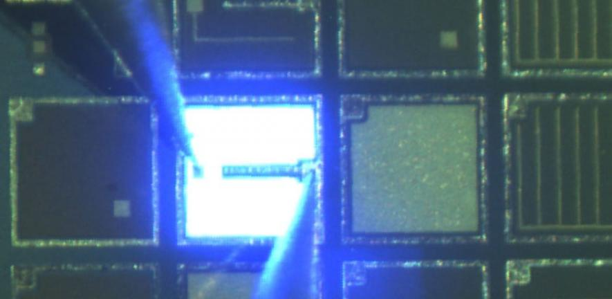 An LED emitting light on a 6-inch silicon wafer.
