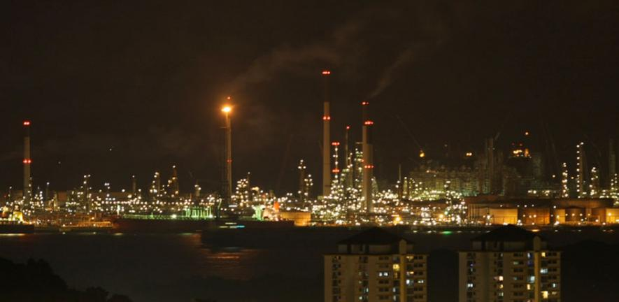 The gas flare at the Jurong Island oil refineries, Singapore.