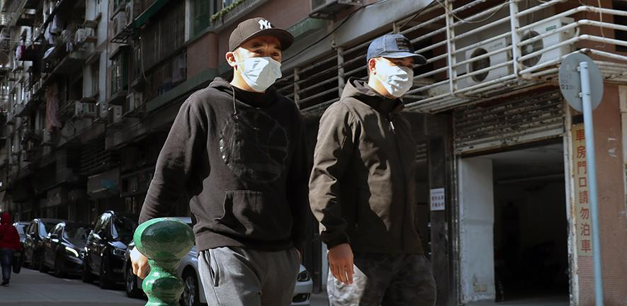 Men in masks, Macau, PRC