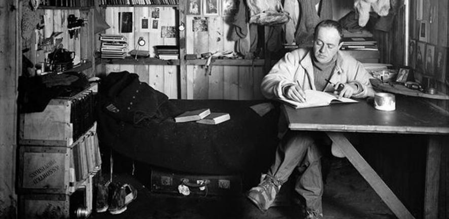 Scott writing in his hut during the fateful Terra Nova expedition.