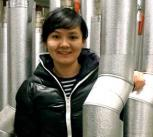 Echo Ouyang standing in a geothermal plant room