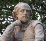 statue of William Shakespeare at the centre of Leicester Square Gardens, London