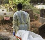 Burial team in Guinea carry a victim of Ebola, 2015. UN Photo/Martine Perret