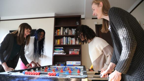 Four students playing table football