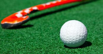 Field hockey ball and stick