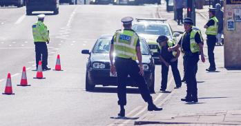 Police stopping traffic in UK lockdown