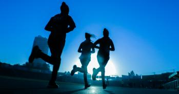 Silhouettes of three women running