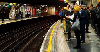 Passengers at a London Underground station