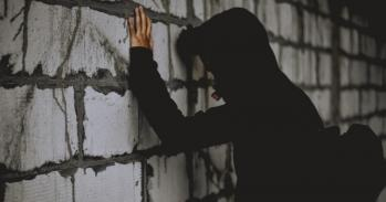 Teenager leaning on a wall