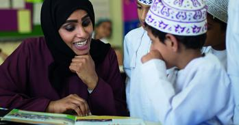 School pupils in Oman reading with their teacher. Image: Cambridge Partnership for Education