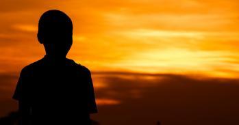 Boy at sunset