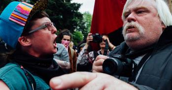 Protestors confront each other at a political demonstration