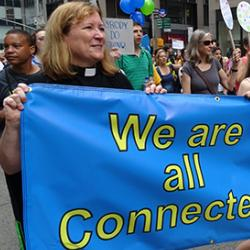 Unitarian Universalist and larger faith contingent taking part in the 21 September 2014 Peoples Climate March
