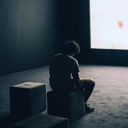 A man sitting in front of a screen