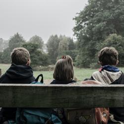 Children sitting on park bench
