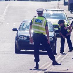 Police stopping traffic in UK lockdown