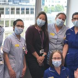 Estee Torok (centre, in black) with team at Addenbrooke's Hospital
