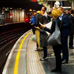 Passengers at a London Underground station