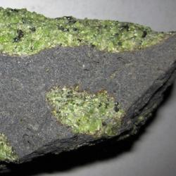 Chunks of exotic green rocks from the mantle erupted from the San Carlos Volcanic Field, Arizona