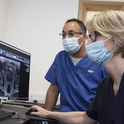 Dr Raj Jena and Yvonne Rimmer look at scans